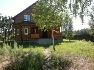 Дома из оцилиндрованного бревна от компании «Вятский лес»